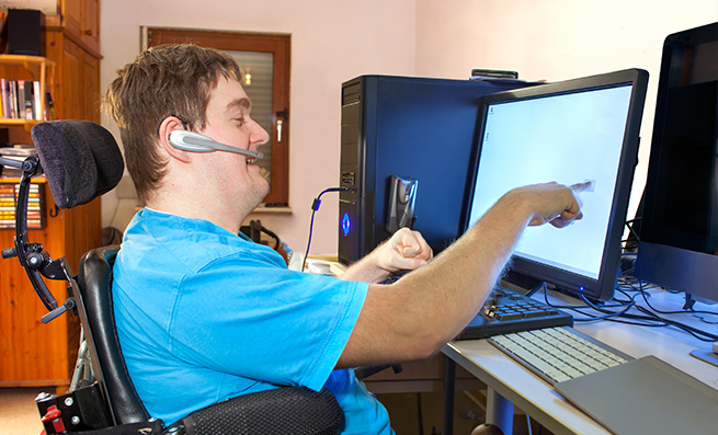 Man with a disability using a computer