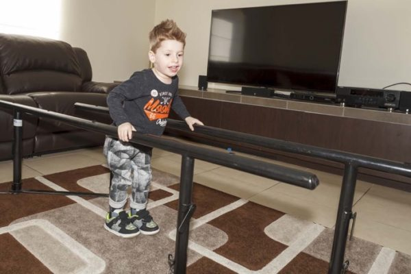 TADSA bars helping child with a disability to walk